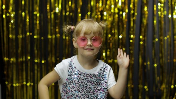 Thumbnail for Child Kid Dancing, Celebrating Victory, Fooling Around. Girl Posing on Background with Foil Curtain