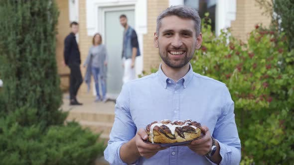 Thumbnail for Smiling Caucasian Man Standing with a Cake and Smiling