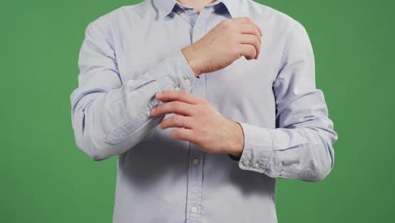 Thumbnail for Man adjusting the shirt sleeves