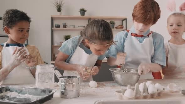 Diverse Children Making Dough in Kitchen
