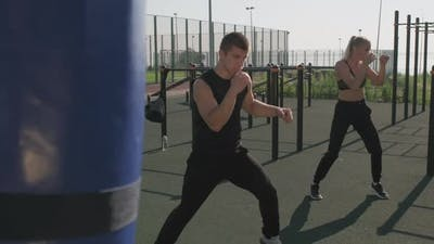 Sport Couple Doing Boxing Exercise