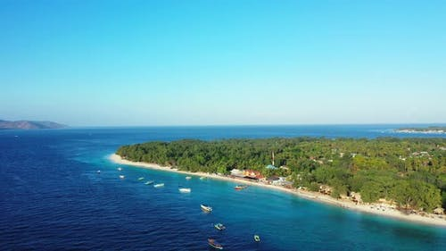 Beautiful birds eye clean view of a white paradise beach and aqua turquoise water background