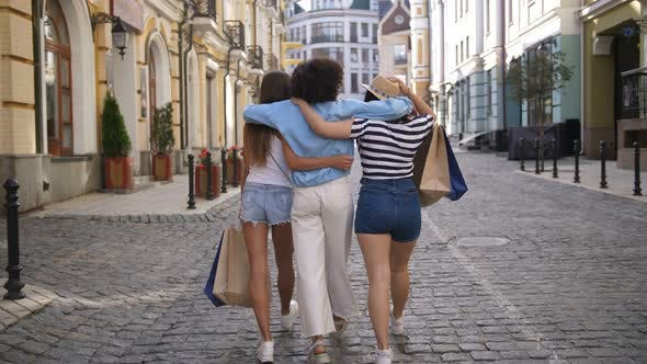 Thumbnail for Back View of Diverse Fashion Girls Shopping