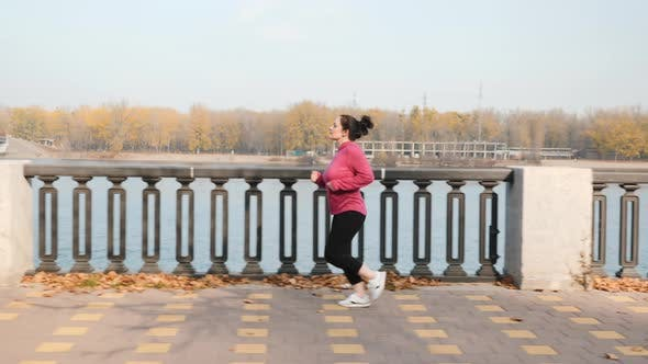 Thumbnail for Chubby woman doing running exercises in the morning as a part of weight loss program