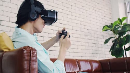 A man wearing virtual reality glasses experiencing innovative technology in the modern home.