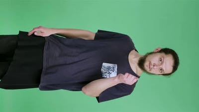 Portrait of a Man with Dark Hair and a Beard on a Green Screen