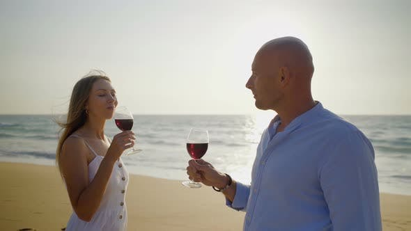 Cover Image for Young Couple Drinking Wine on Beach