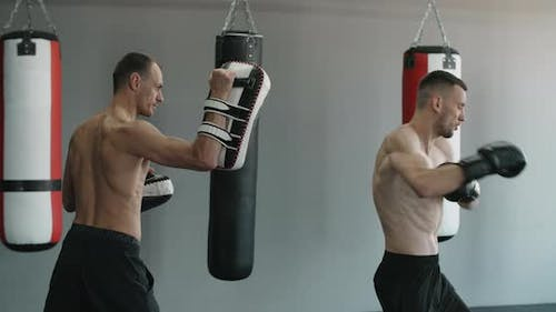 Kickboxer Does Roundhouse Kick in Slow Motion Kickboxers are Training in the Gym  120Fps Prores HQ
