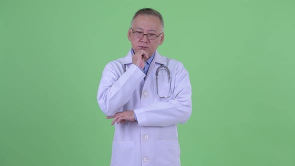 Thumbnail for Stressed Mature Japanese Man Doctor Thinking and Looking Down