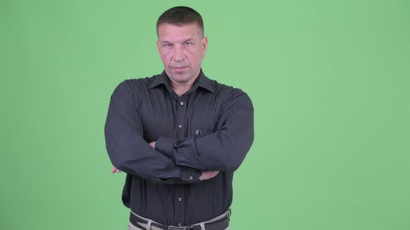 Thumbnail for Serious Macho Mature Businessman with Arms Crossed