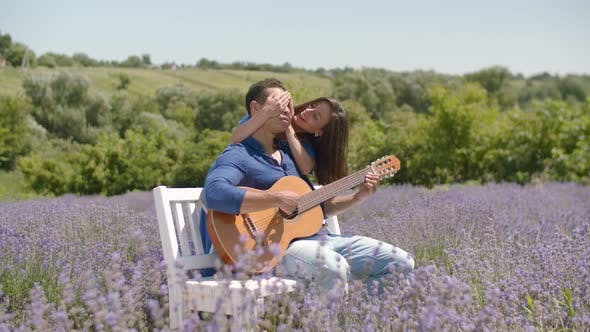 Thumbnail for Multiethnic Couple with Guitar Relaxing in Nature