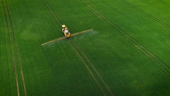 Thumbnail for Tractor Spraying Fertilizer on Spring Field