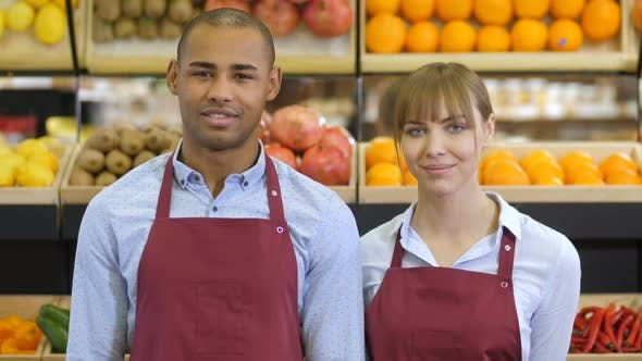Cover Image for Cheerful Diverse Shop Clerks at Grocery Store
