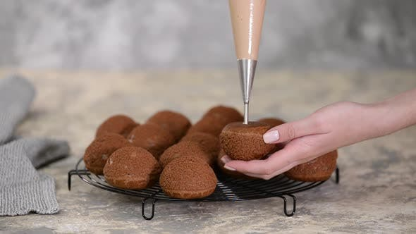 Thumbnail for A Chef Filling a Chocolate Profiteroles with Cream