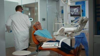 Dentist Examining Teeth with Medical Instruments
