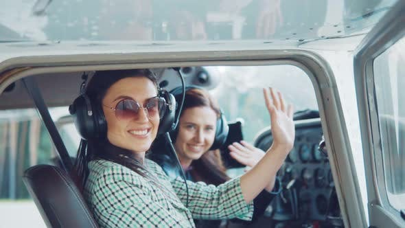 Cover Image for Young Attractive Girls in an Airplane at the Helm.