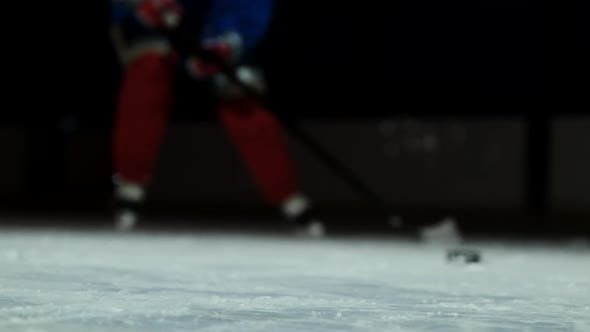 Thumbnail for Close-up of the Puck Is on the Ice and in Slow Motion Hockey Player Pulls Up and the Snow Flies