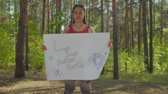 African Ecology Female Activist Holding Placard
