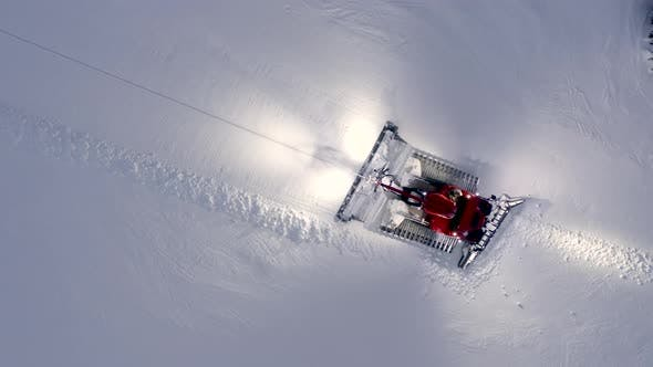 Thumbnail for High Above Snow Grooming Machine At Ski Resort Aerial Top Down Shot