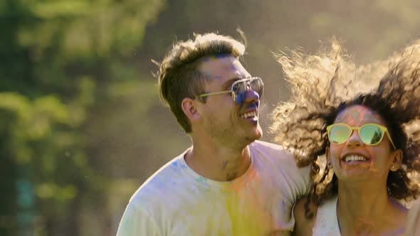 Thumbnail for Couples in Love Having Good Time, Enjoying the Festival of Colors in Slow Motion