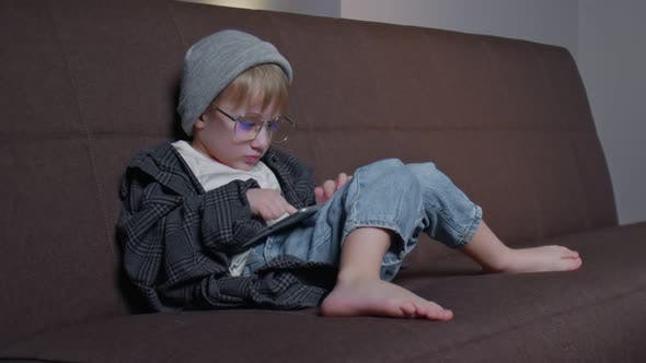 Hipster Little Boy Playing with Tablet at Home