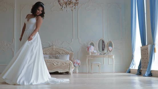 Portrait of a Beautiful Young Bride  Young Woman in a Lush White Dress in the Hall