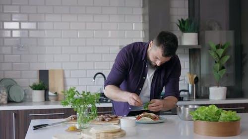 Handsome Man Cooking Healthy in Kitchen