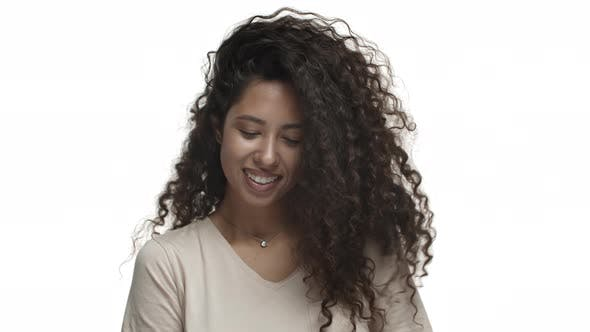 Closeup of Attractive Carefree Woman with Long Curly Hairstyle Whip Hair and Smiling Happy Enjoying