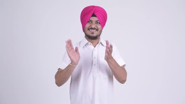 Thumbnail for Happy Bearded Indian Sikh Man Wearing Turban and Clapping Hands