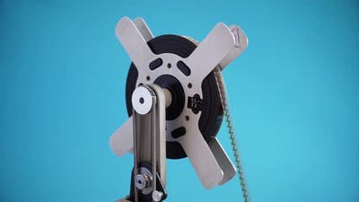 Rotating Old Filmstrip On A Vintage Film Projector.
