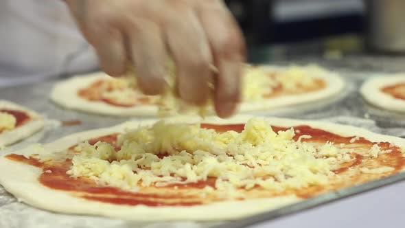 Thumbnail for Cook Making Italian Pizza