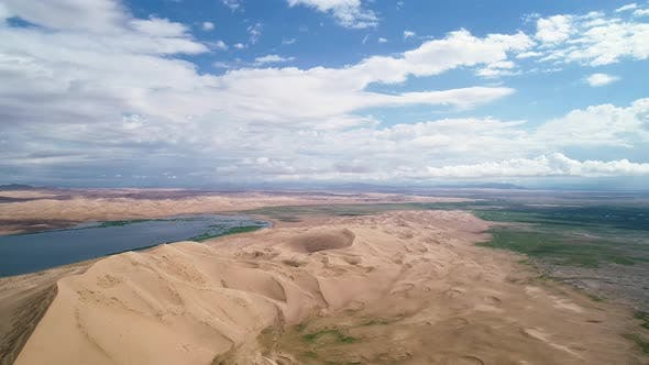 Thumbnail for Panoramic view from above on a sandy desert with lakes
