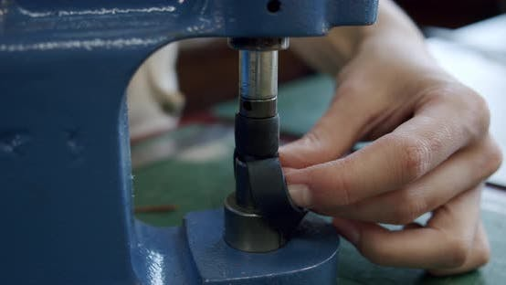 Thumbnail for Close Up Shot of Specialist Working with Leather Female Hands Installs Rivets on a Leather Product