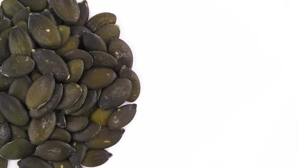 Thumbnail for View From Above. Half Part of Circle Shaped Pumpkin Seeds Pile
