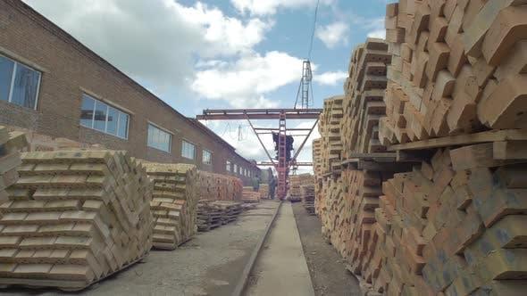 Thumbnail for Pile of bricks outside a factory