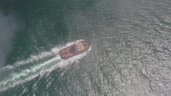 Drone View of the a Tugboat in Motion