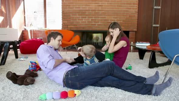 Thumbnail for Family playing in living room