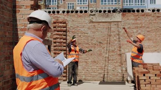 The Foreman Checks the Progress of Construction