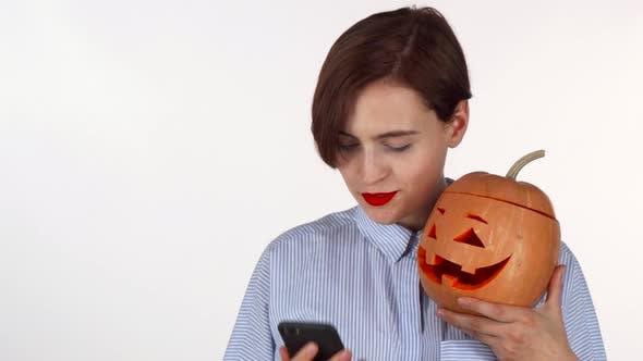 Thumbnail for Beautiful Young Woman Taking Selfies with Halloween Pumpkin
