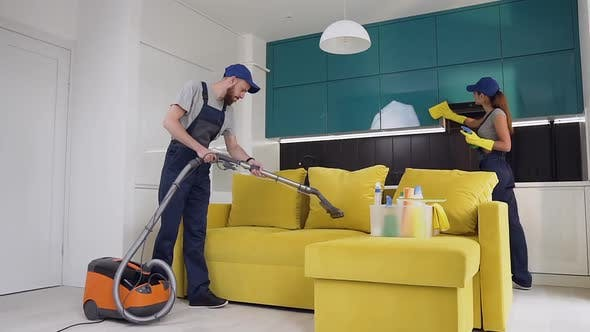 Thumbnail for Workers from Cleaning Service Where Man Vacuuming the Sofa and Woman Wiping a Furniture