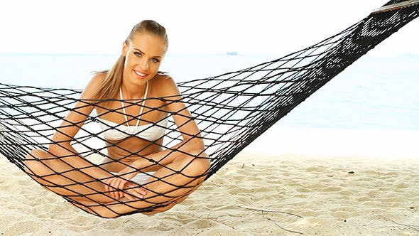 Thumbnail for Happy Blond Girl Relaxing on Hammock