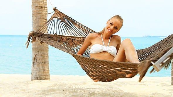 Thumbnail for Sexy Girl in Bikini Lying on Hammock
