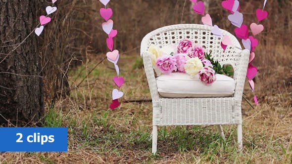 White Chair and a Garland of Paper Hearts