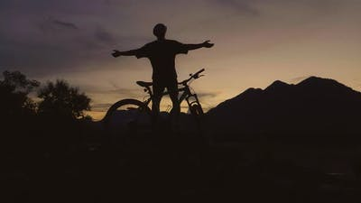 Silhouette Of Happy Cyclist