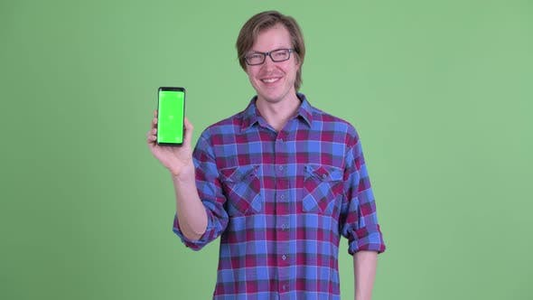 Thumbnail for Happy Young Handsome Hipster Man Pointing and Showing Phone