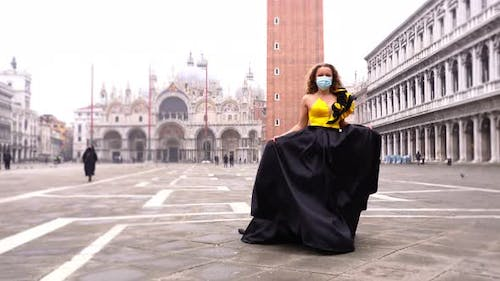 Model Holds Dress Hem and Performs Defile Along Square