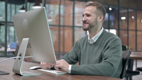 Working Man Doing Video Chat on Computer