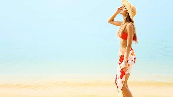 Thumbnail for Beautiful Girl Walking on the Beach