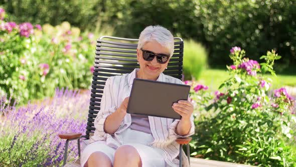Thumbnail for Happy Senior Woman with Tablet Pc at Summer Garden