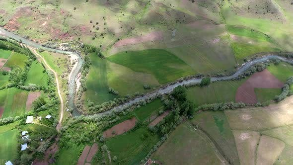 Thumbnail for Little Village Houses Surrounded by Green Meadows and River in Fields